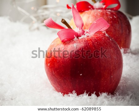 Red delicious Christmas apples in snow