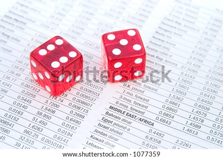 Red dice on top of a financial newspaper. Shallow Depth of field. - stock photo