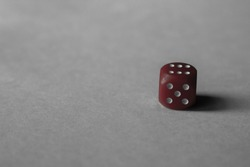 Red dice on white paper background, picture for background, for disign or presintation.