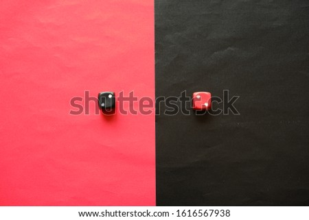 Red dice shows two and black dice shows two.