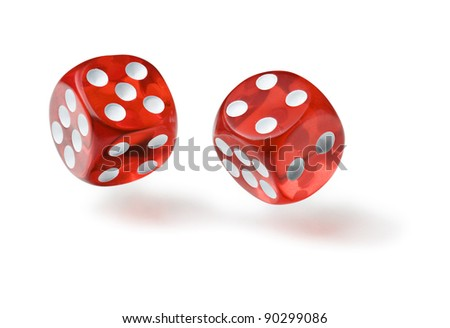 Red dices in midair on white background close up