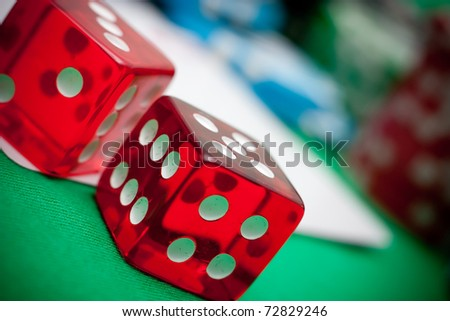 red dices,  objects against casino background