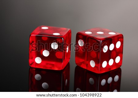 Red dices on grey background
