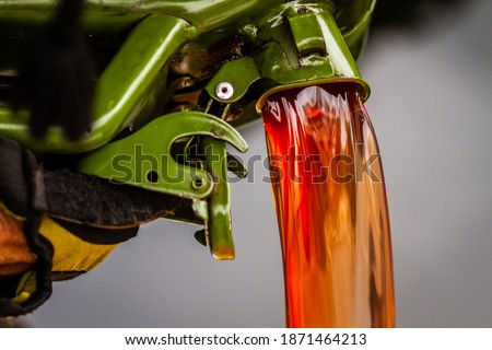 red diesel being poured into a container in a steady stream Stock photo ©
