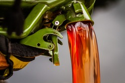 red diesel being poured into a continer in a steady stream