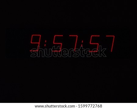 Red Digits of Race Clock at Black Background