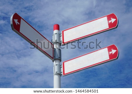 red direction sign on the pole against the blue cloudy sky. white arrow signal against heaven with clods.  empty frame blank  #1464584501