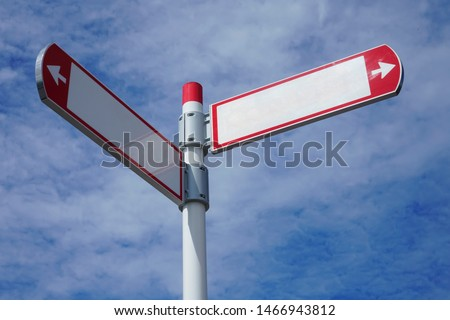 red direction sign on the pole against the blue cloudy sky. white arrow signal against heaven with clods.  empty frame blank  #1466943812