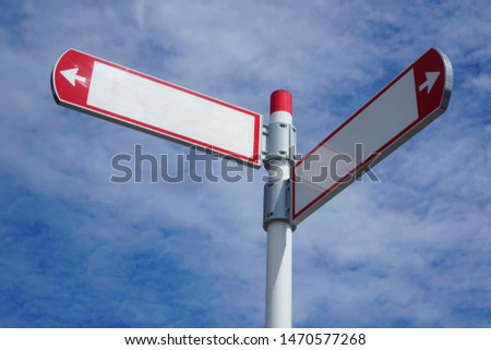 red direction sign on the pole against the blue cloudy sky. white arrow signal against heaven with clods.  empty frame blank  #1470577268
