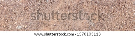 Red dirt (soil) background or texture. Ground texture background of brown desert soil, dry earth and sand. horizontal design. Сток-фото ©