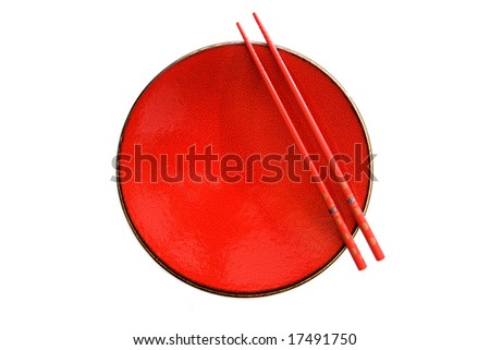 Red dish and chopsticks with oriental style on a white background