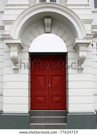 red door in a white arch