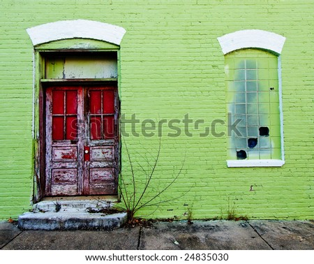 Red Door on Green Wall