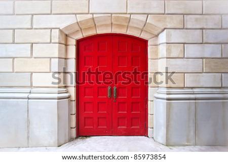 Red door on white brick background