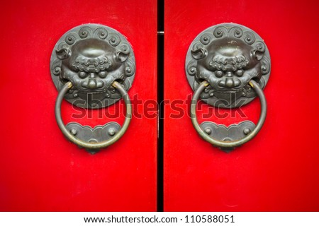 Red door with Chinese design