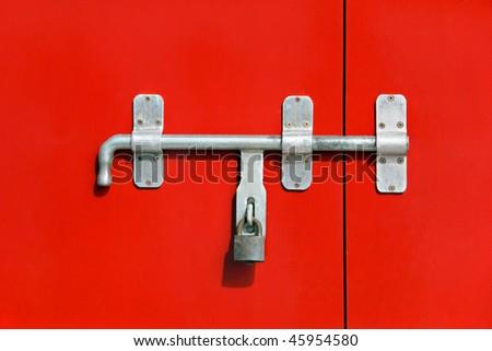 Red door with iron lock #45954580
