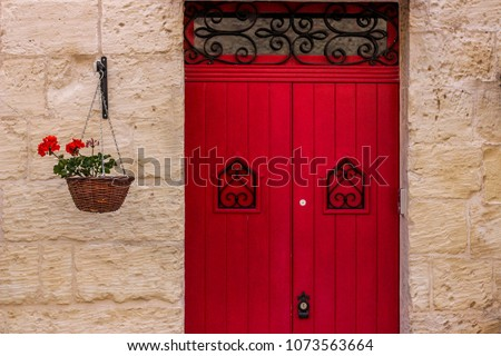 red doors with decorative red...