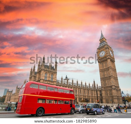 Red Double Decker Bus under Big Ben and Westminster Bridge.