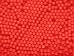Red dragee balls background for your design
