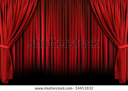 Red draped theater stage curtains with light and shadows