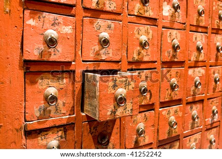 Red drawer of old fashioned chinese cabinet - stock photo