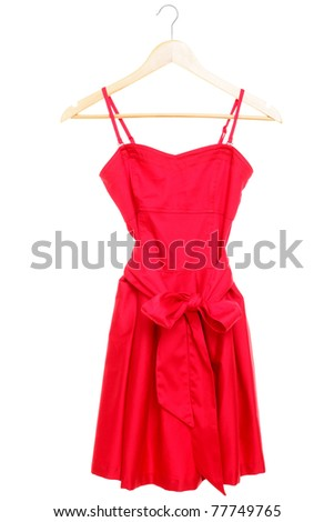 Red dress on hanger isolated on white background.
