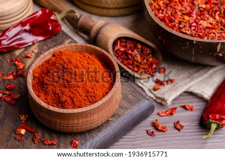 Red dried pepper on a dark wooden background. Selective focus. Stockfoto ©