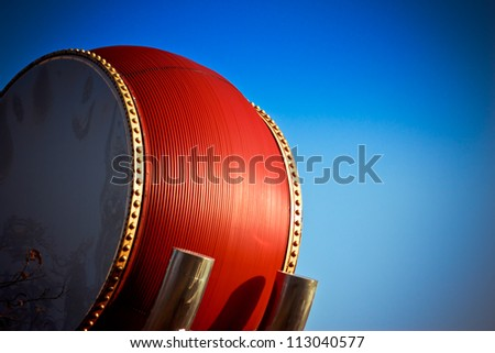 Red drum set with background of blue sky,Beijing,China
