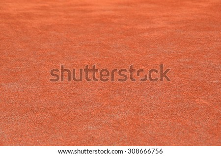 Red dry grungy clay tennis textured background