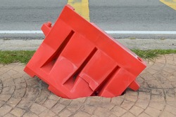Red duty plastic safety road barrier, equipment barricading o roadside, preventing peoples or another vehicles collision against into the hole.