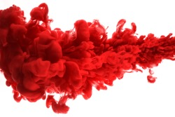 red dye in water on white background