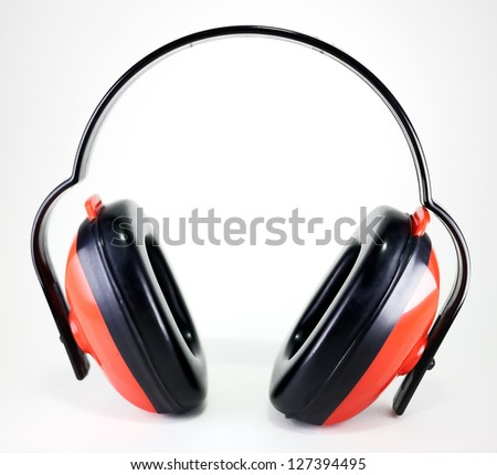 red earmuffs to protect worker's ears from noise isolated on white