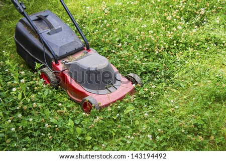 red electric lawn mower