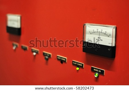 Red electricity meter showing voltage. For concepts such as electricity, energy, and industrial concepts.