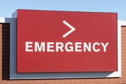 Red Emergency Entrance Sign for a Local Hospital