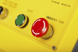 Red emergency stop switch and green reset button