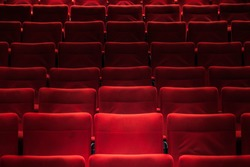 Red empty chairs in the theatre