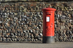 Red English pillar box or post box.