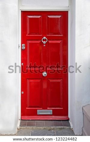 red entrance door in front of...