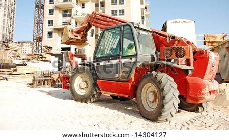 red excavator on construction site
