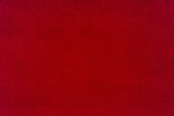 Red fabric background texture. Red cloth. Fabric surface for banner background. Top view.