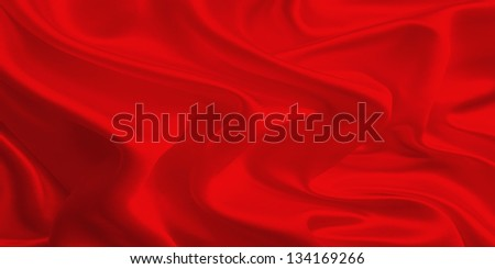Red fabric flag waving on the wind