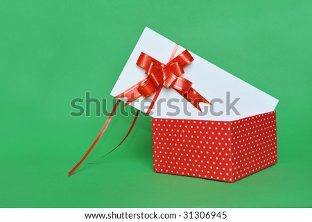 Red fabric gift box over White card. Top open