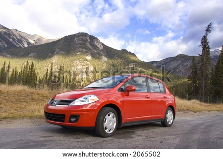 red family car in the mountains