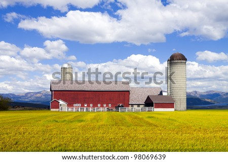 Red Farm in Colorado with Cloudy Sky