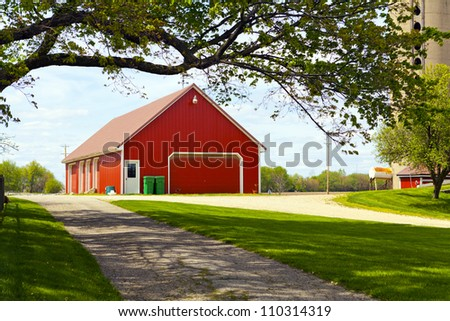Red Farm With Cloudy Sky