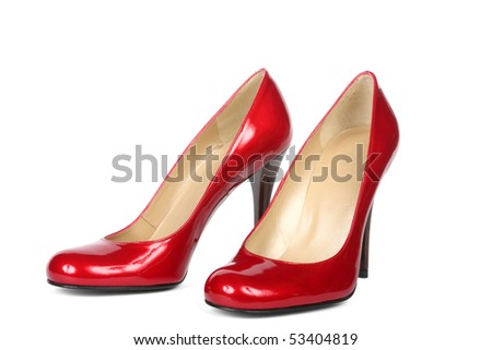 Red female shoes on a high heel. It is isolated on a white background