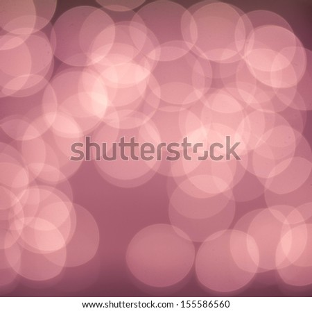Red Festive sunrise background. Bright abstract Christmas background with glowing bokeh.