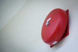 red fire alarm on the wall