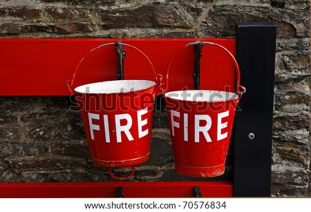 Red fire buckets at an old railway station